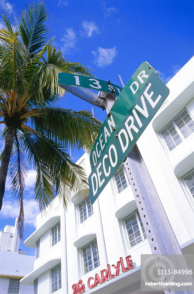 Street sign Ocean Drive with Hotel The Carlyle, South Beach, Miami, Florida, USA
