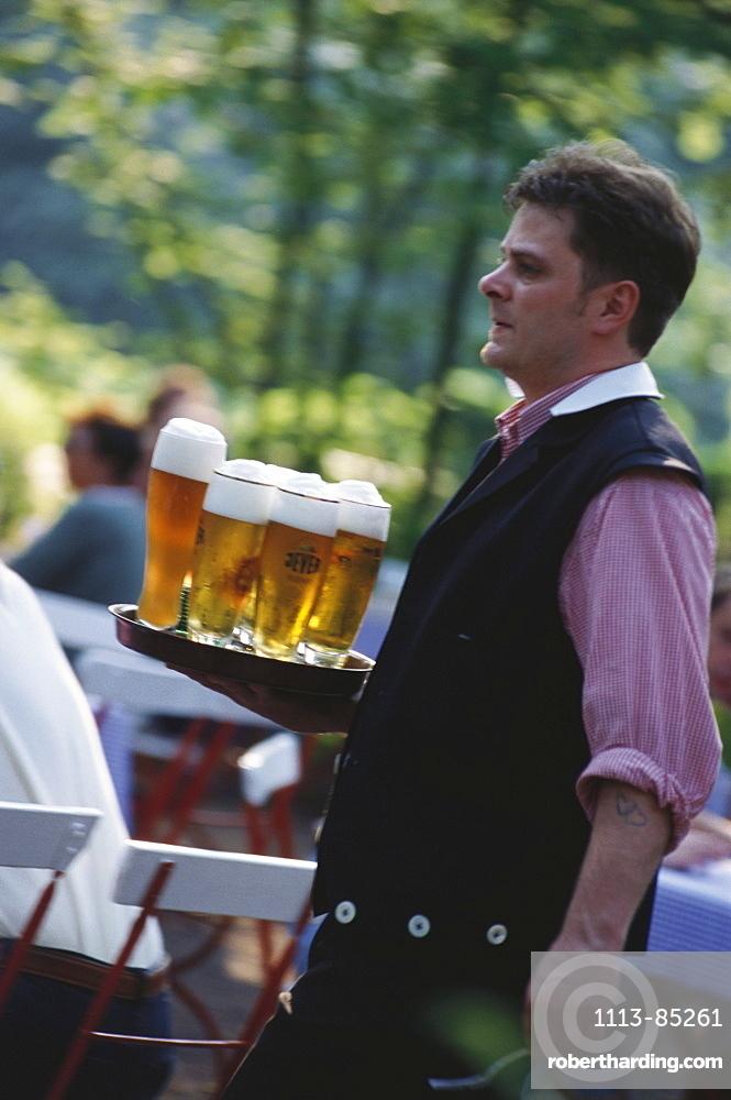 A waiter serving beer in a beer garden, Weissbier, Beer, Leisure, Germany