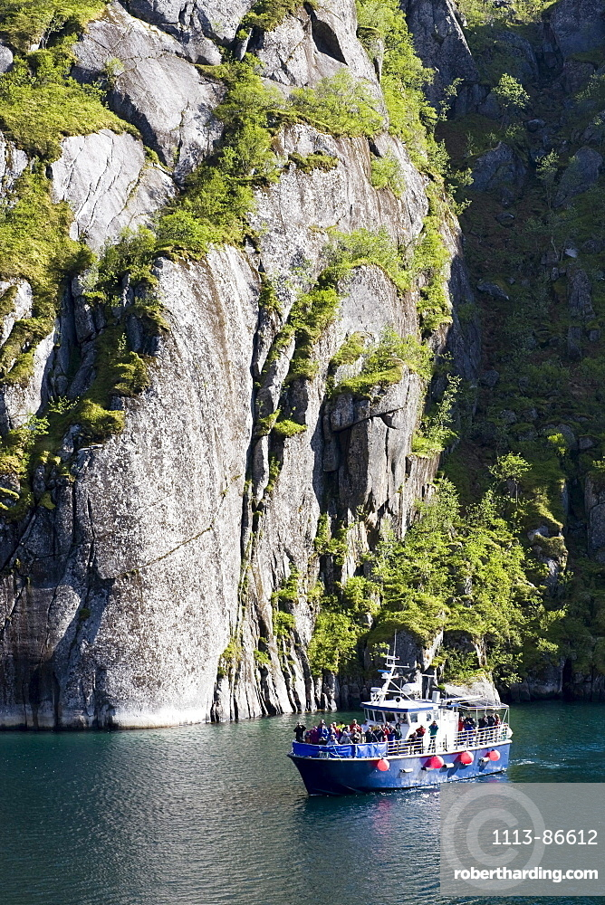 An excursion boat on a Fiord at the Island of Austvagoya, Trollfjord, Lofoten, Norway