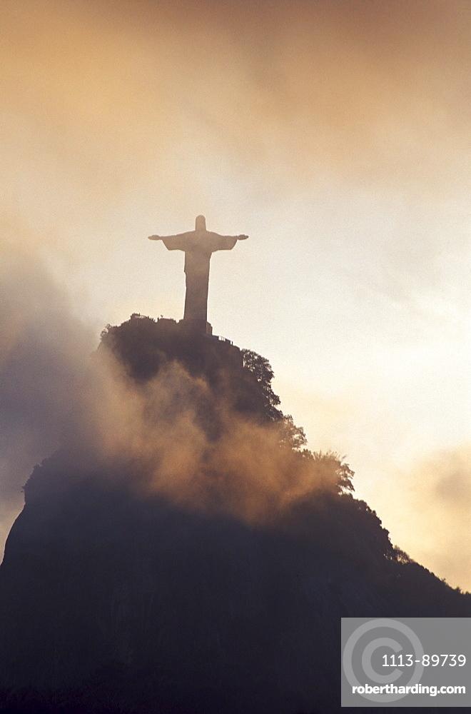 Christ the Redeemer statue on Corcovado mountain in fog, Rio de Janeiro, Rio de Janeiro, Brazil