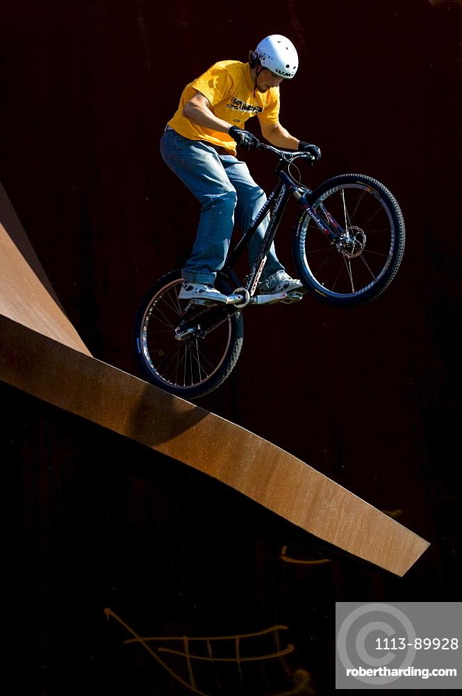 Trial biker on metal sculpture, Linz
