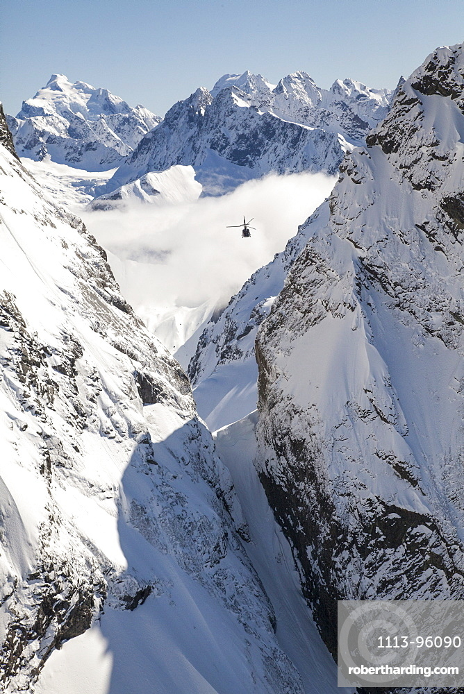 Helicopter flight over snowy mountains, Southern Alps, South Island, New Zealand