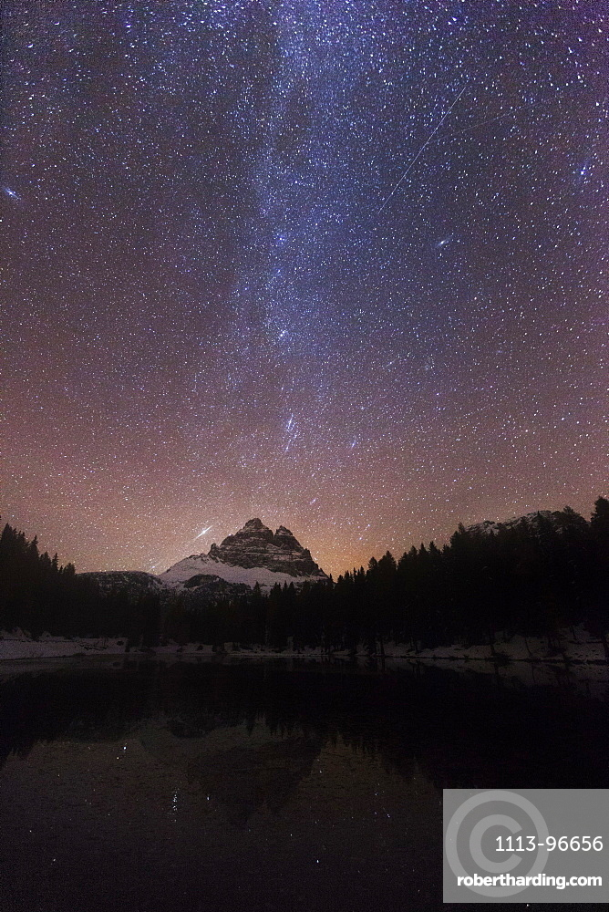 Impressive night sky with the Milky Way over Lago de Antorno and view towards the Tre Cime di Lavaredo from the South-west, South Tyrol, Italy