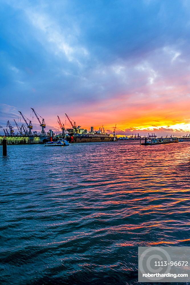 Sunset inHamburg harbour and the shipyard Blohm+Voss, Hamburg, Germany
