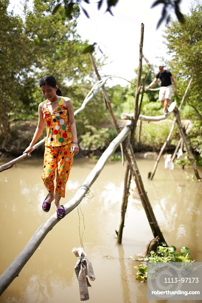 Monkey bridge crossing canal near Cao Lanh, Dong Thap, Vietnam