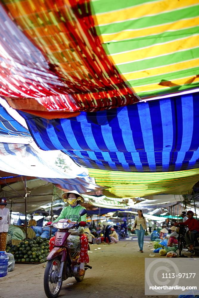 Market stalls under colourful canvas, Sa Dec, Dong Thap Province, Vietnam