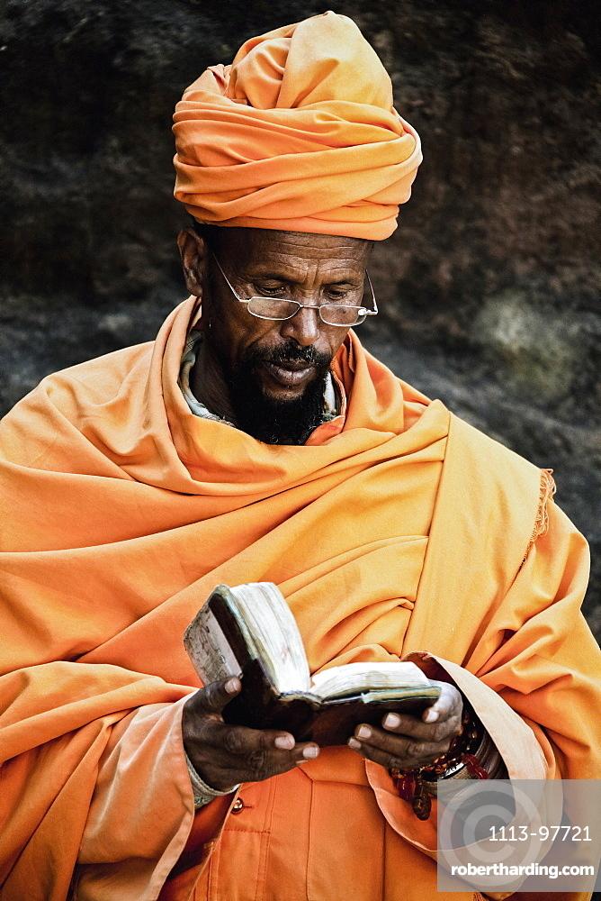 Priest reading the bible, Lalibela, Ethiopia, Africa