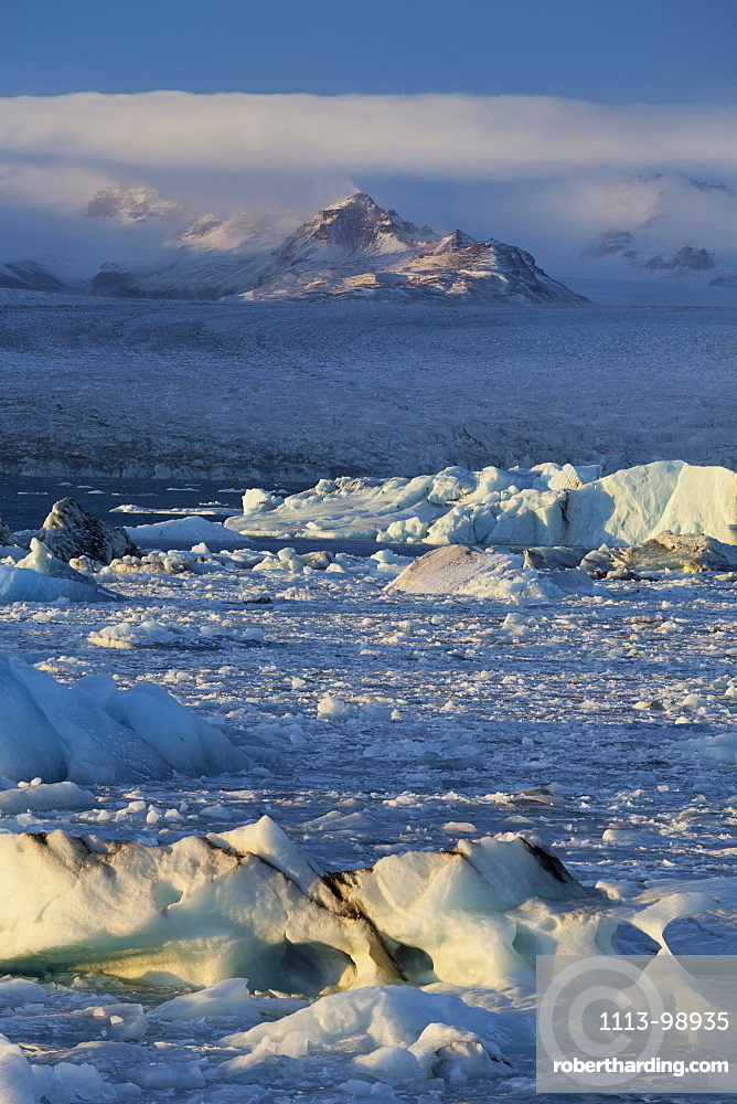 Icebergs in the waves in the glacial lake, Jokulsarlon, East Iceland, Iceland