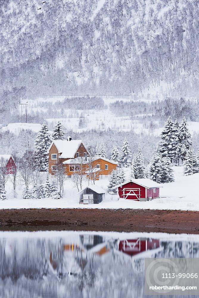Reflection of houses in the fjord, Fiskefjorden, Hinnoya, Vesteralen, Nordland, Norway