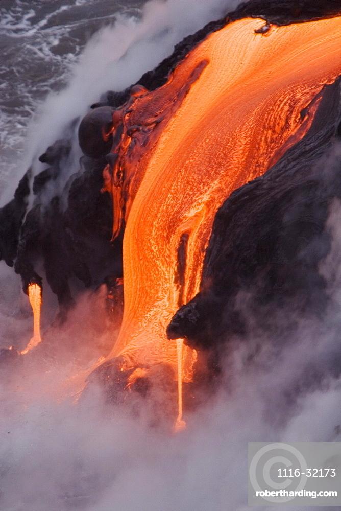Hawaii, Big Island, near Kalapana, Close-up of pahoehoe lava flowing from Kilauea into Pacific Ocean.