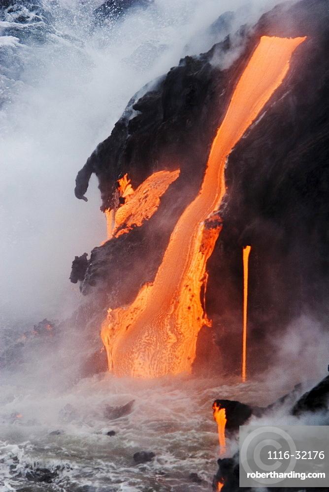Hawaii, Big Island, near Kalapana, Pahoehoe lava flowing from Kilauea into Pacific Ocean, Steam rising.