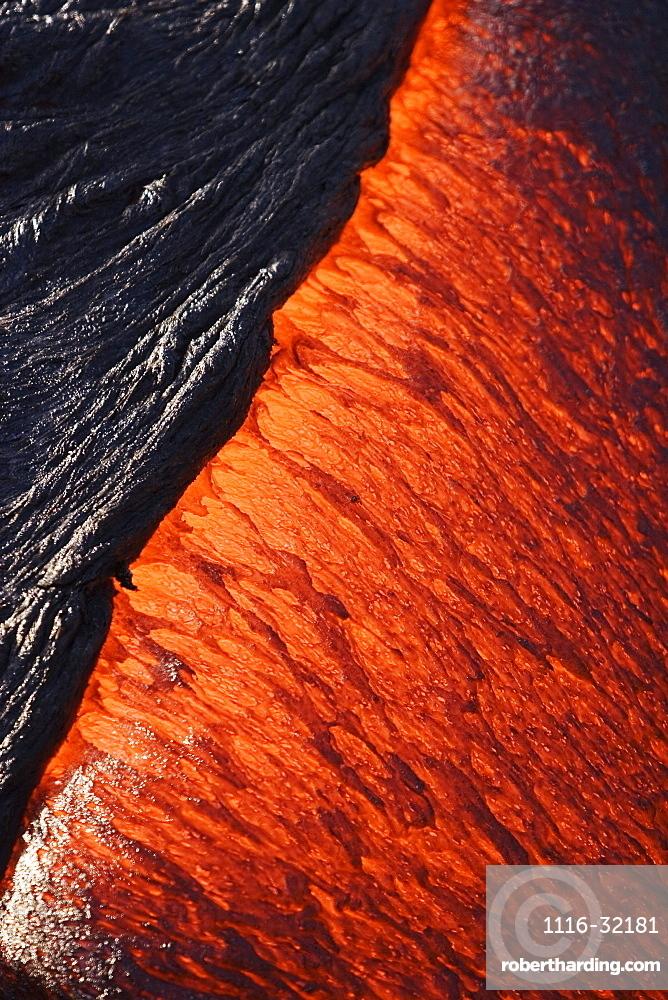Hawaii, Big Island, Hawaii Volcanoes National Park, Kilauea Volcano, Detail of molten pahoehoe lava flowing downward.