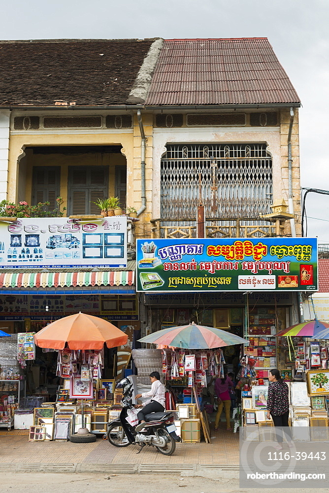 Some shops in Battambang, building in French architectural style, Battambang, Cambodia