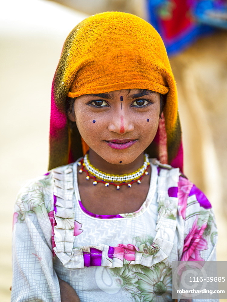 Portrait of a young Indian girl with markings on her face, Kanoi, Rajasthan, India