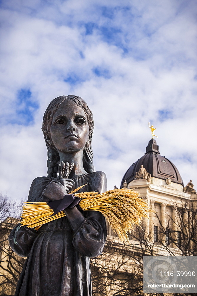 ""\""""Bitter Memories of Childhood"""" is a memorial statue on the Manitoba Legislative Grounds which pays tribute to the 1932-1933 Ukrainian Famine and Genocide under Soviet ruler Joseph Stalin. The Legislative Building and the Golden Boy are seen in the backgro""668|1000|?|en|2|d37edbf80e1db10f280d022db6a99609|False|UNLIKELY|0.3402641713619232