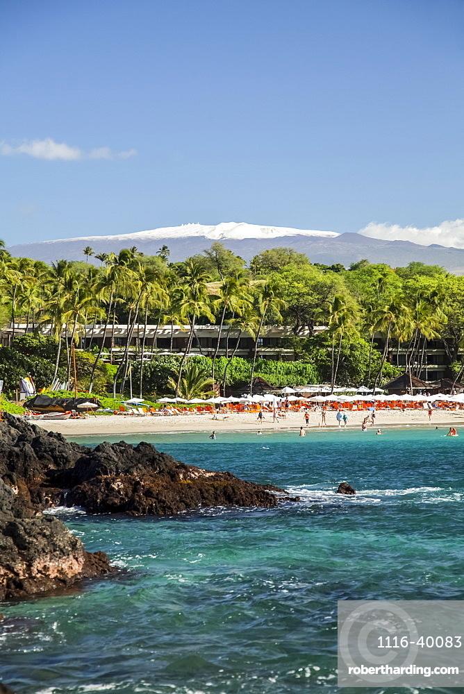 Kaunaoa Beach, Mauna Kea Beach and Hotel, and a view of Mauna Kea with snow on the Big Island, Island of Hawaii, Hawaii, United States of America