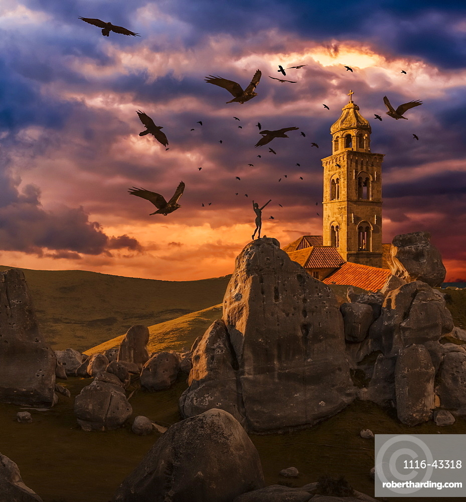 Crows flying towards a church tower with a wooden human mannequin laying on the ground in the foreground
