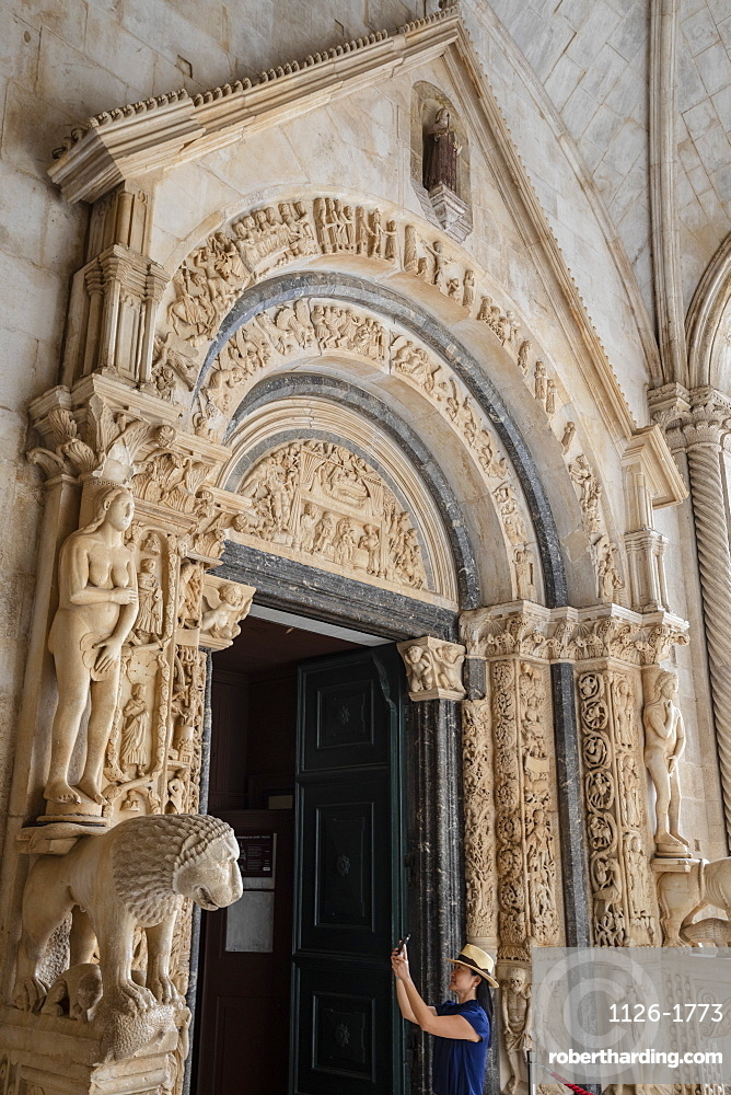 Stone carving outside The Cathedral of St. Lawrence, Trogir, UNESCO Wold Heritage Site, Croatia, Europe