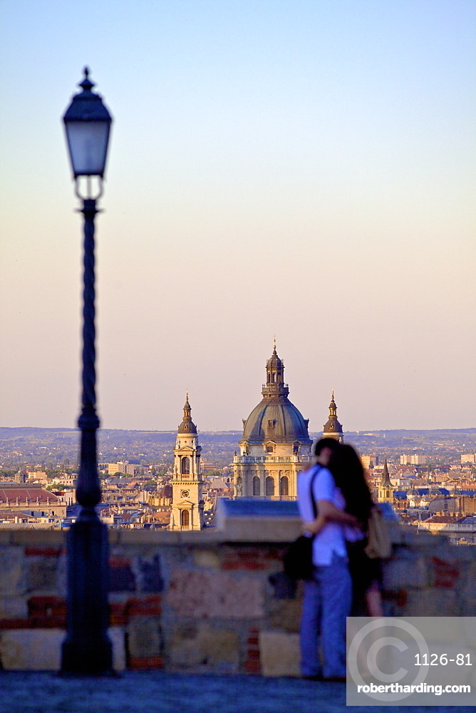Couple looking at view over the city from Buda Castle, Budapest, Hungary, Europe