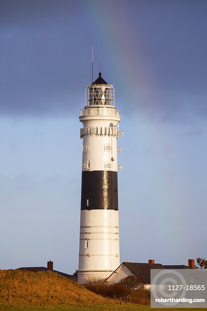 Rainbow over lighthouse, Red Cliff lighthouse, Kampen, Sylt island, North Frisian Islands, Schleswig-Holstein, Germany