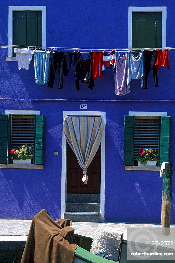 House front with clothesline, Burano, Italy