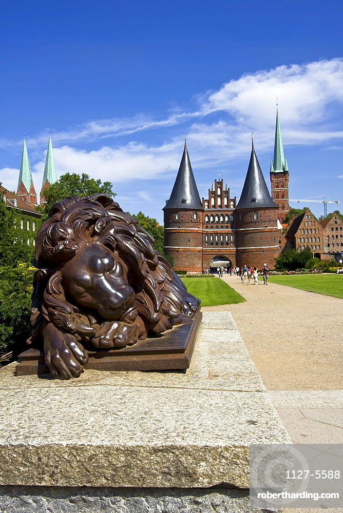 Iron sculpture 'Sleeping lion' at Town Gate, Holstentor, Lubeck, Schleswig-Holstein, Germany / Lubeck