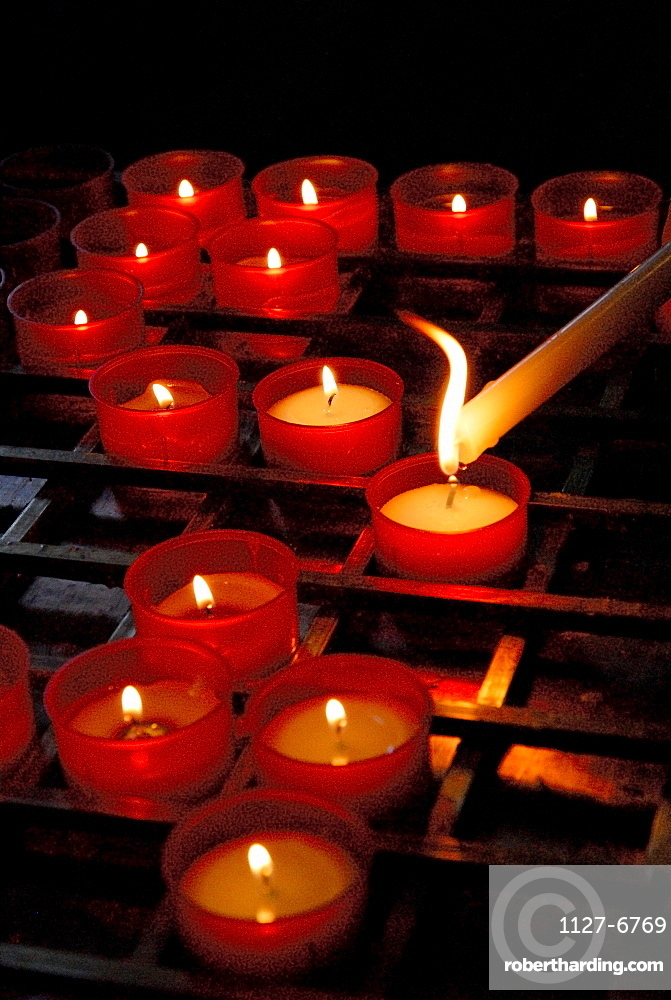 Lighting candle in church