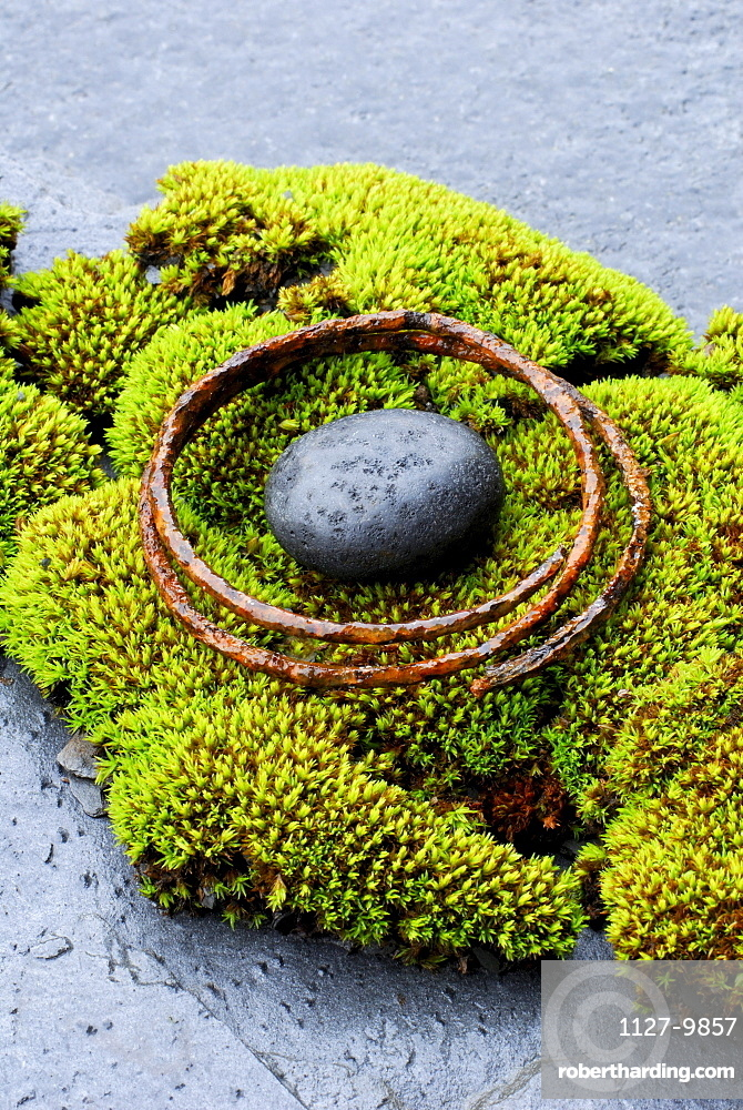 Stone and rusty metal ring