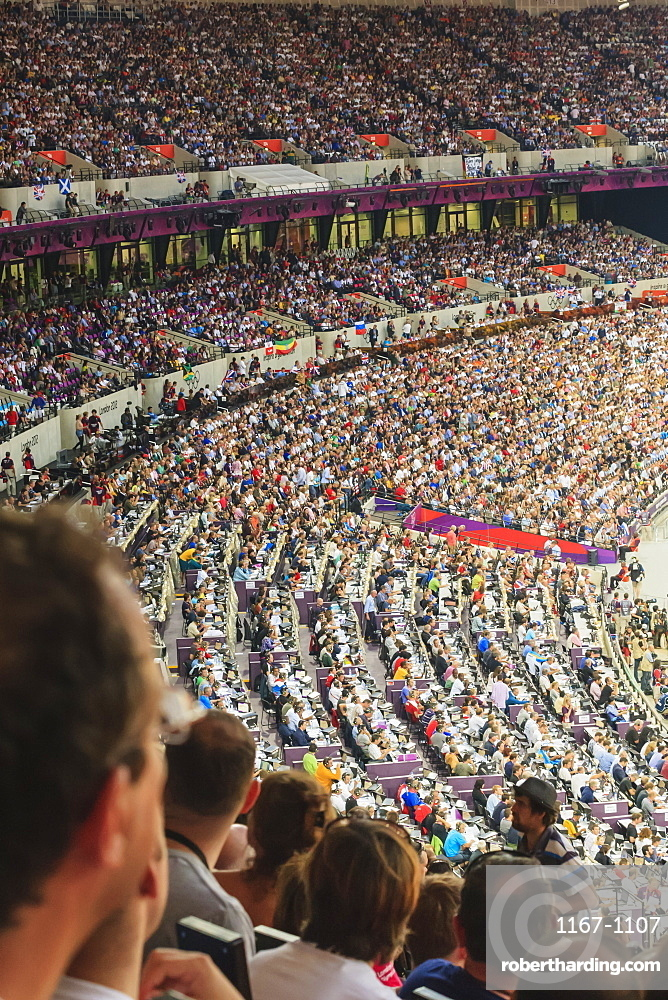 Spectators in a packed Olympic Stadium, including media area, London 2012, Summer Olympic Games, London, England, United Kingdom, Europe