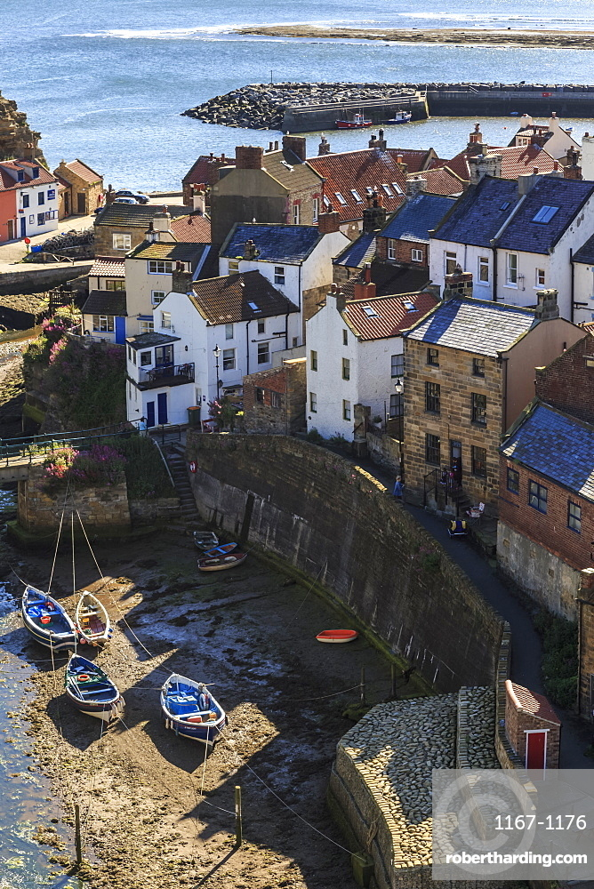 Winding alleys of village, fishing boats and sea, elevated view in summer, Staithes, North Yorkshire Moors National Park, Yorkshire, England, United Kingdom, Europe
