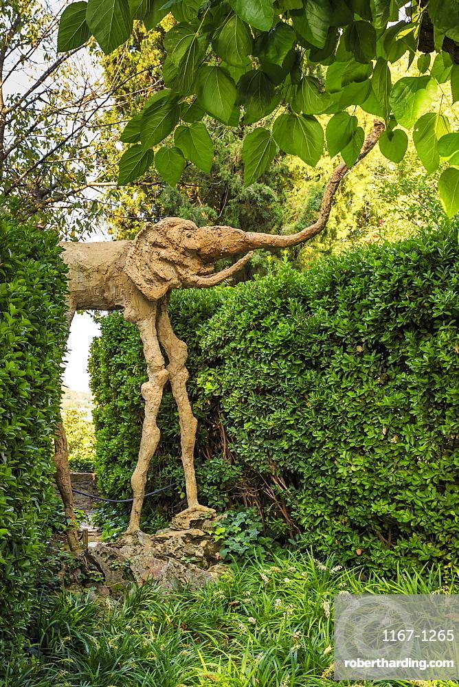 Gala Dali Castle Museum, elephant statue in garden, medieval home museum of Salvador Dali, Pubol, Baix Emporda, Girona, Catalonia, Spain, Europe