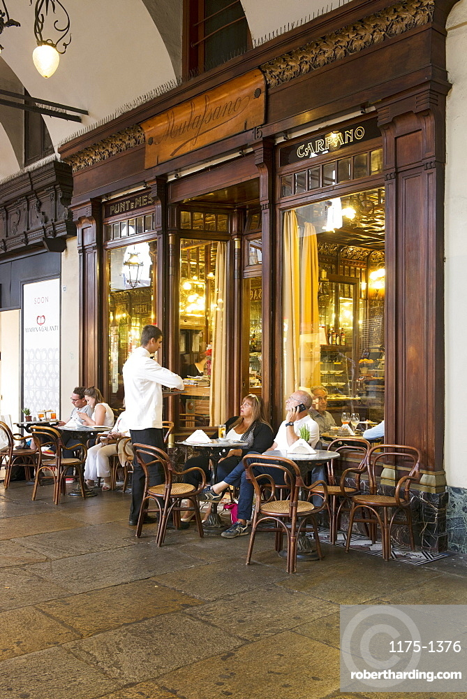 People in the street cafe 'Caffè Mulassano' on Castello Square, Turin, Italy