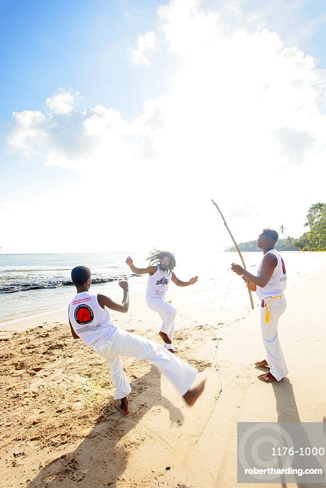 Local people playing capoeira on the beach, Boipeba Island, Tinhare, Brazil, South America