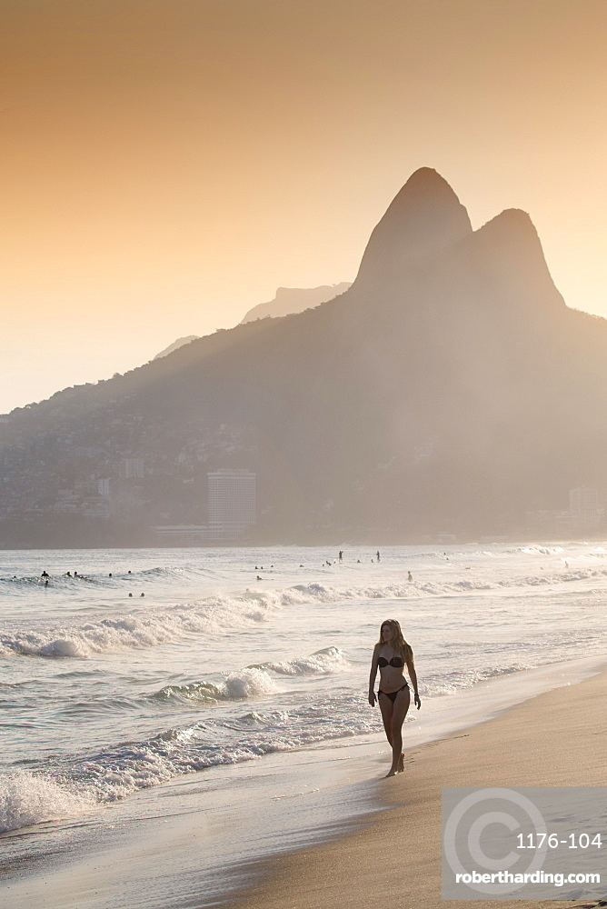 Ipanema and Leblon beach at sunset with the Morro dos Dois Irmaos (Two Brothers) hills behind, Rio de Janeiro, Brazil, South America