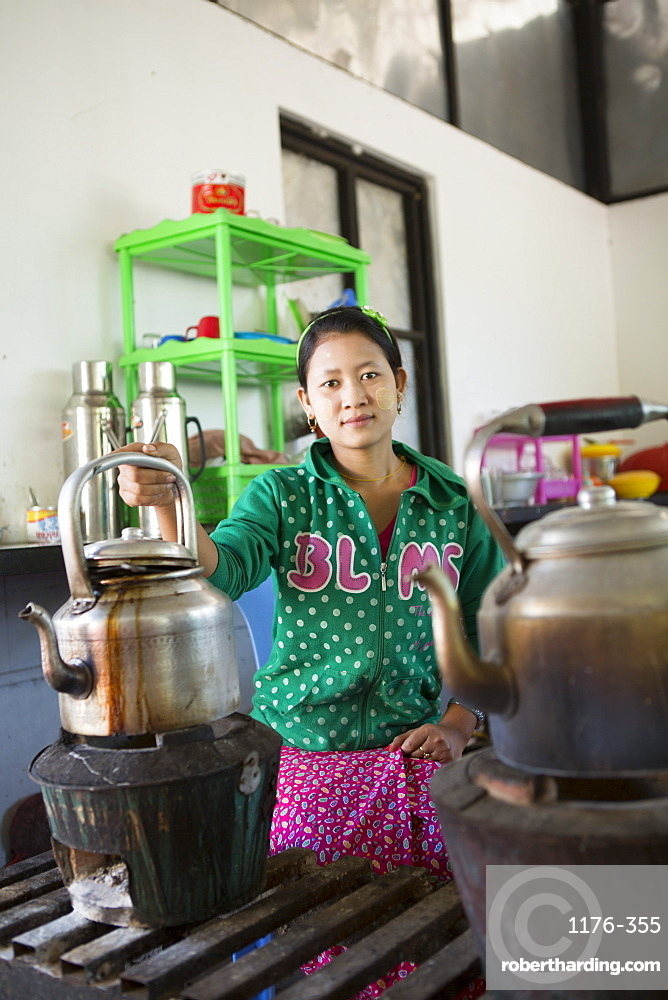 Local woman preparing tea in a huge kettle, Mandalay, Myanmar, Southeast Asia