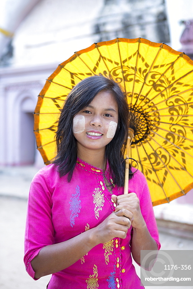 A local girl with a traditional paper sunshade umbrella and thanaka face paint, Monywa, Sagaing, Myanmar (Burma), Southeast Asia