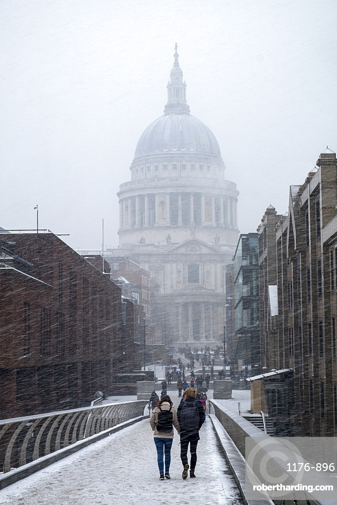 View of St. Paul's Cathedral and the Millennium Bridge in snow, London, England, United Kingdom, Europe
