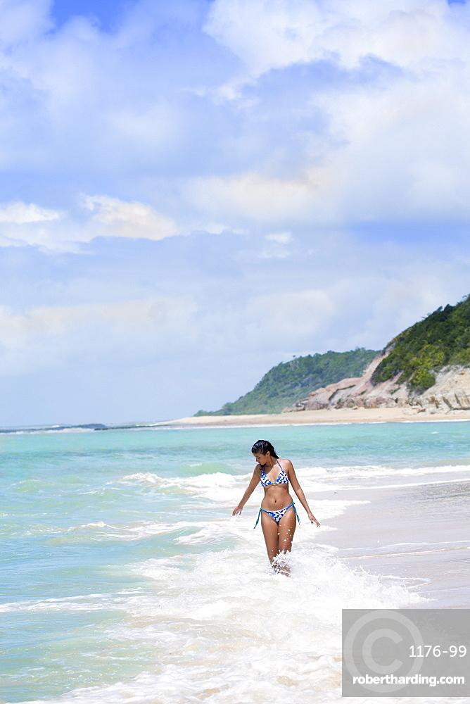 An attractive young Brazilian woman on Espelho Beach (Mirror Beach), Trancoso, Bahia, Brazil, South America