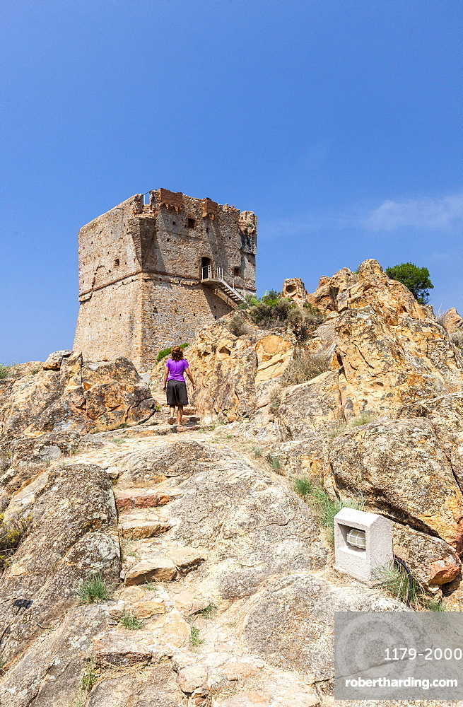 Genoese tower of granite rocks built as fortress of defense framed by blue sky, Porto, Southern Corsica, France, Mediterranean, Europe