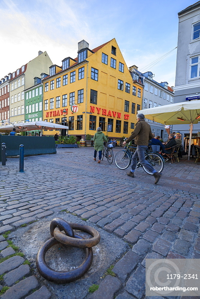 People walk in the pedestrian roads of the entertainment district of Nyhavn, Copenhagen, Denmark, Europe