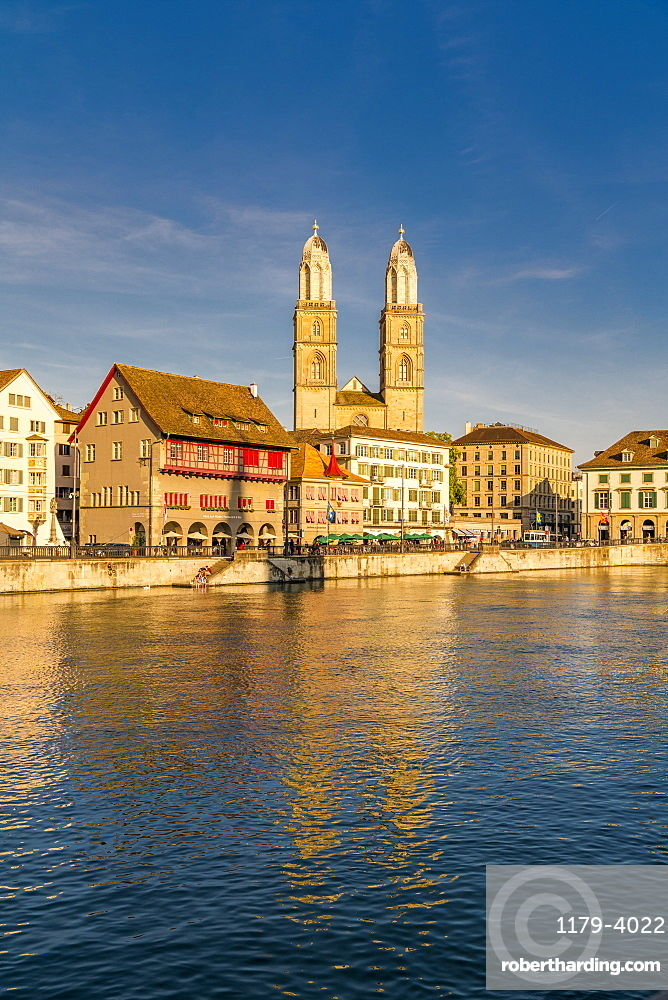 Sunset over Grossmunster Cathedral and Limmatquai street along the banks of Limmat River, Zurich, Switzerland