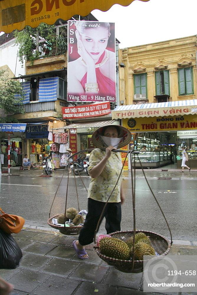Vietnam woman carrying durian, hanoi