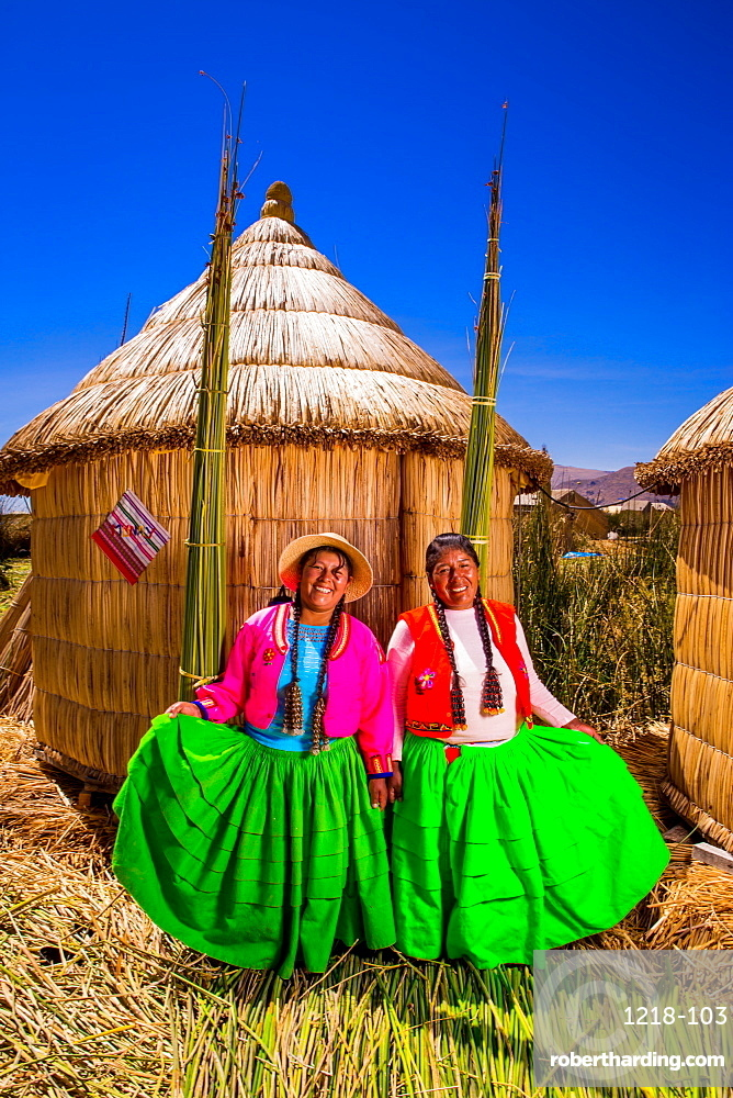 Two Quechua Indian women on Floating Grass islands of Uros, Lake Titicaca, Peru, South America