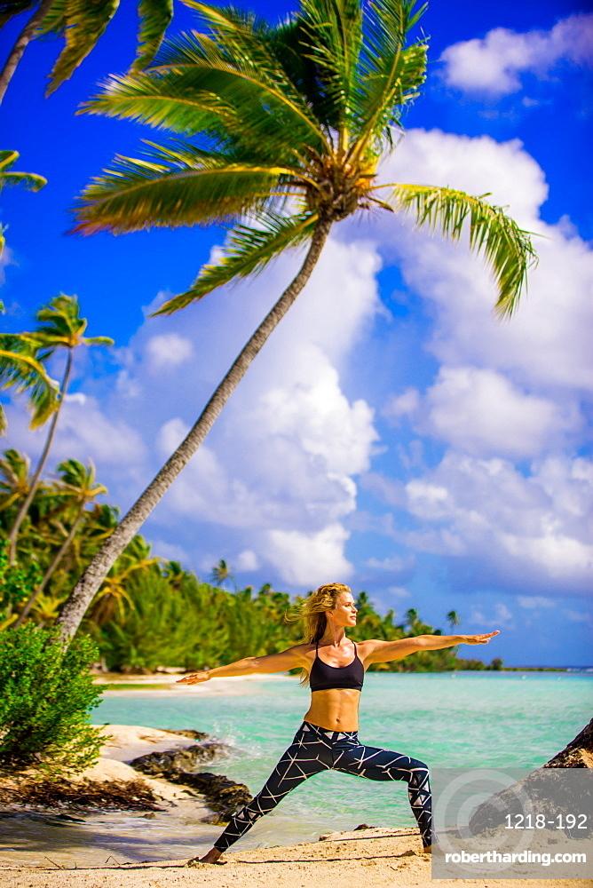 Woman doing yoga, Le Taha'a Resort, Tahiti, French Polynesia, South Pacific, Pacific
