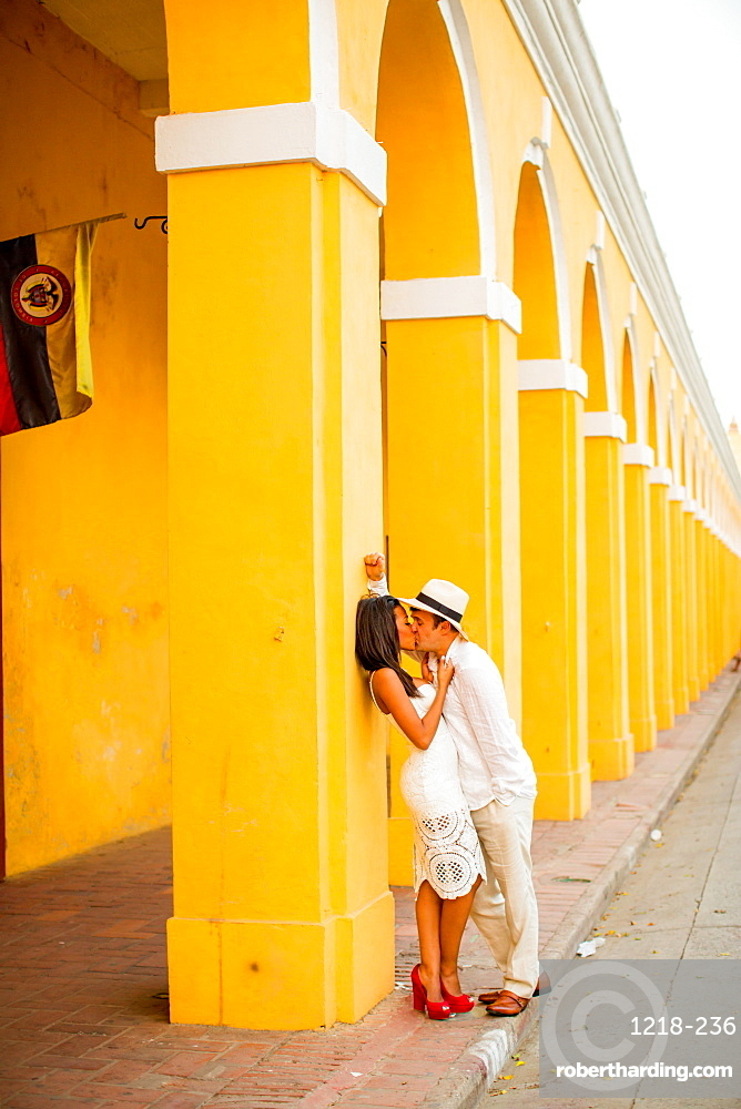 Couple posing in the street, Old Walled-in City, Cartagena, Colombia, South America