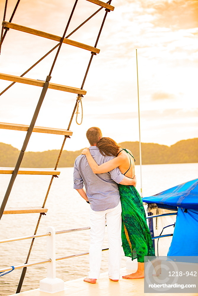 Couple enjoying the sunset on the Palau Siren, Koror Island, Palau, Micronesia, Pacific