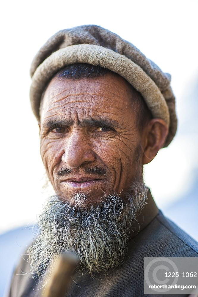 A man photographed along the Karakoram highway, Karakoram, Pakistan, Asia