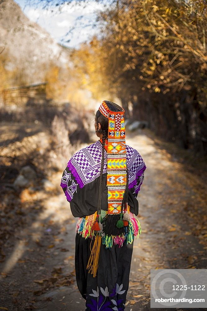 Kalasha woman from Kalasha valley wearing traditional dress, North West Frontier Province, Pakistan, Asia