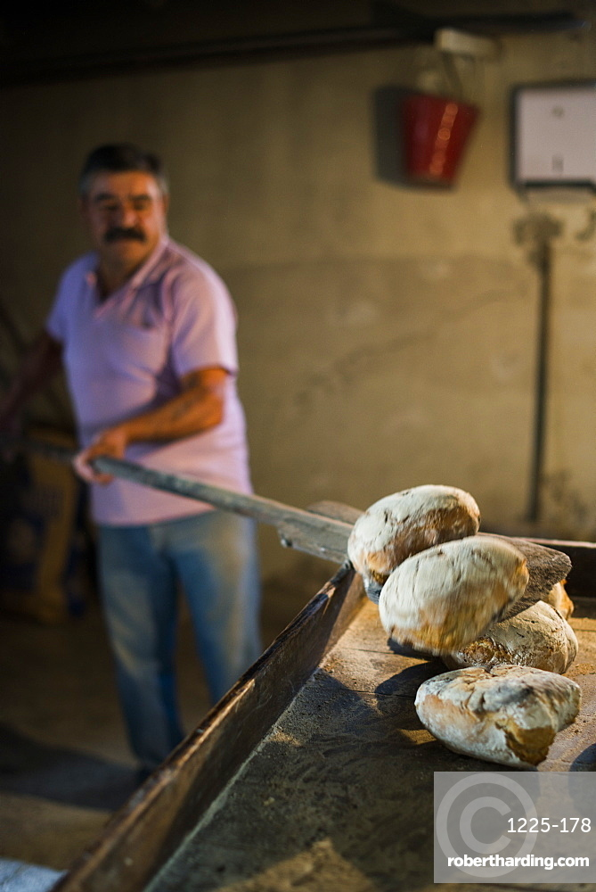 Freshly baked bread in a traditional little bakery in the Alto Douro region of Portugal, Europe