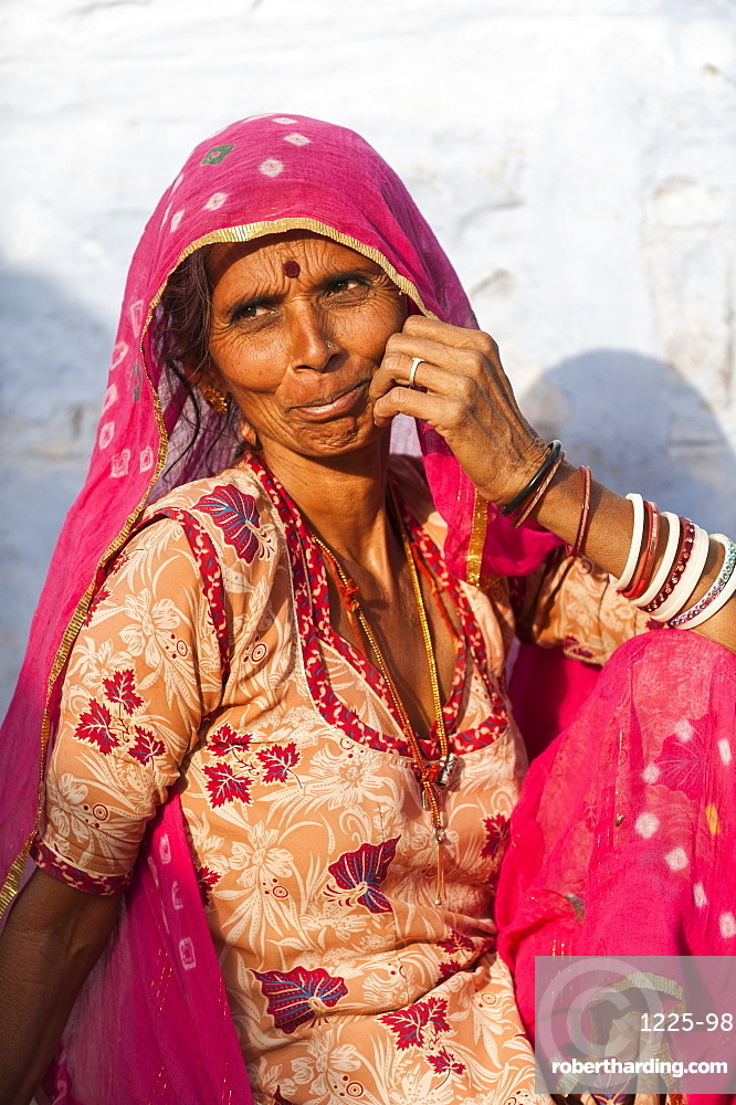 A Rajasthani woman wearing a traditional veil called a Ghoonghat, Rajasthan, India, Asia
